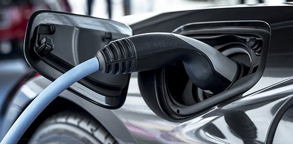 electric-car-at-charging-station-TDVPEFZ
